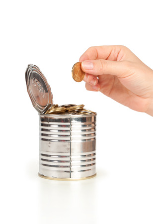 hand put coin in tin with coins photo