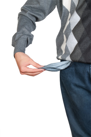 hands on pockets: Young man pulling out empty pocket on isolated background
