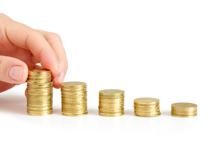 coins in finger and row stacks them isolated on white photo