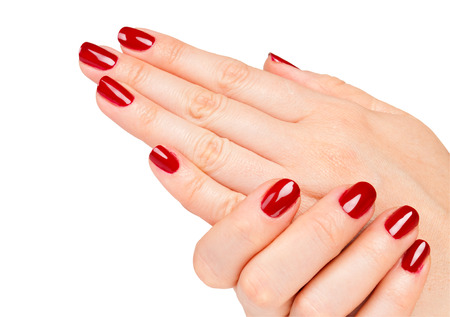 nail art: Close up of Female hands with red manicure