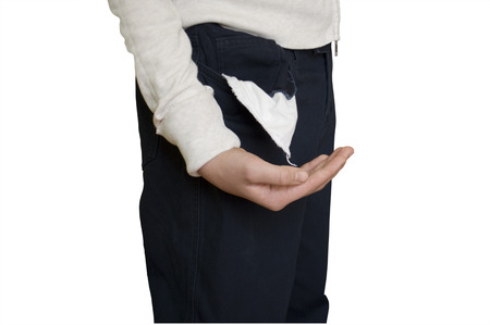 empty pocket: Young man pulling out empty pocket on isolated background