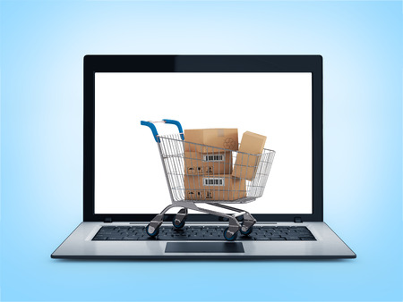 Online shopping concept. Shopping Cart with Boxes over Laptop on a white background photo