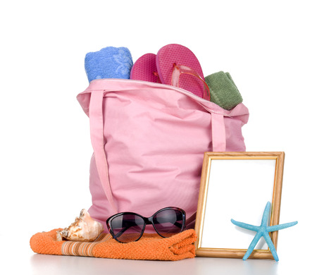 swimming shoes: Beach bag with items for a day at the seaside on white background