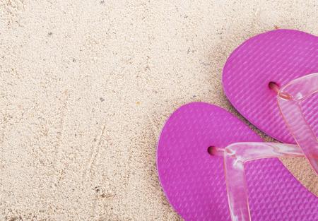 flipflops: flip-flops on a sunny pile of sand Stock Photo
