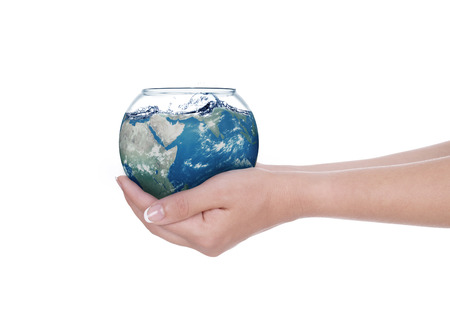 Globe in human hand against blue sky  Environmental protection concept  photo