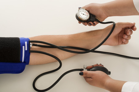 arterial: taking an arterial blood pressure by medical equipment tonometer