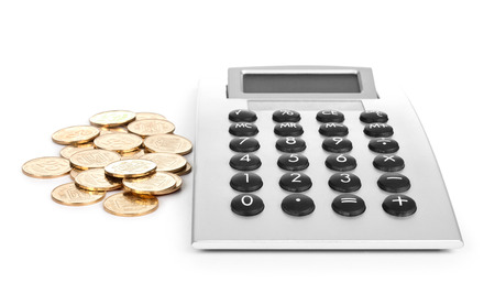 coins and calculator on a white background photo