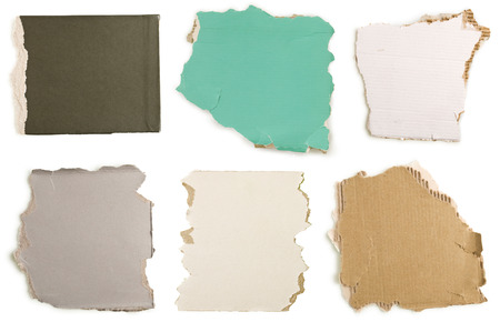 collection of ripped colorful cardboard on a white background photo