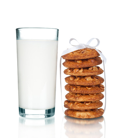 Chocolate Chip Cookies and a glass of Milk, natural light. photo