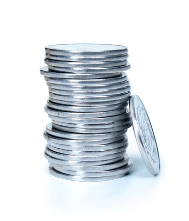 Stacks of silver,metal coins isolated on a white background. photo