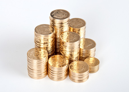 stacks of golden coins isolated on a white background. photo
