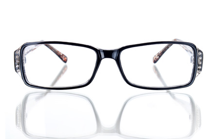 shortsighted: Black glasses frame on a white background with space for text