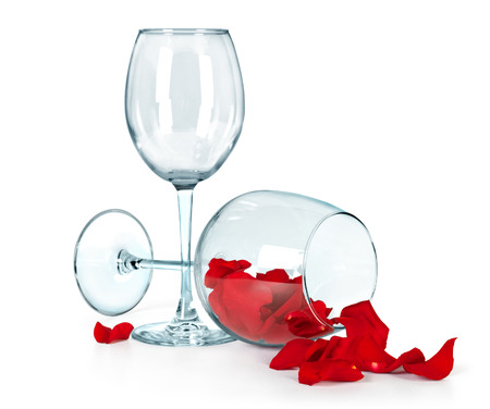 two crysta lvine glasses,a light red rose on a white background photo
