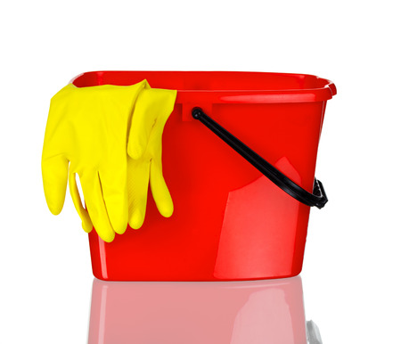 bucket and gloves isolated on white photo
