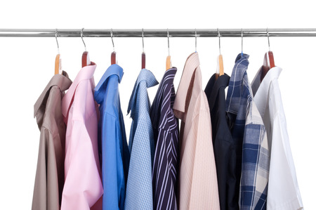 A colorful shirts on metal hanger, isolated photo