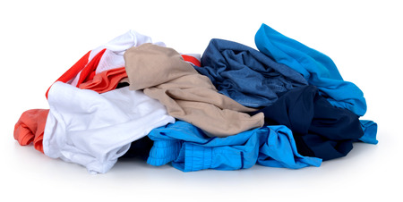 Big heap of colorful clothes isolated on white background Stock Photo