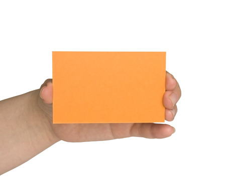 hand holding an orange paper on white background photo