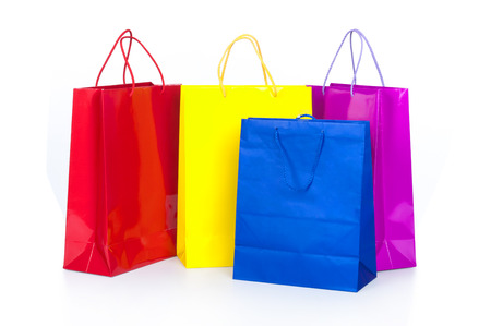Colorful shopping bags in row isolated on white Stock Photo