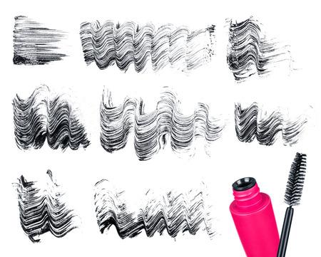 Mascara brush and strokes isolated on white photo