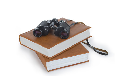 low scale magnification: field-glass and heap of books, tool for information search