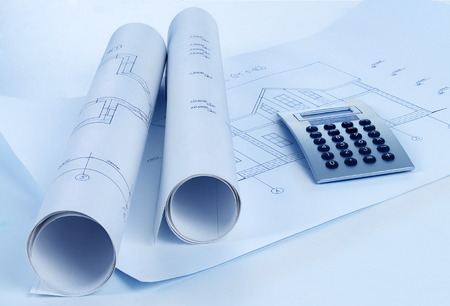 metric: rolls of architecture blueprint, house plane   metric folding ruler