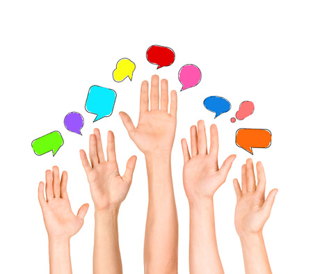 Group of Diverse Multi Ethnic Hands Reaching for Speech Bubbles photo
