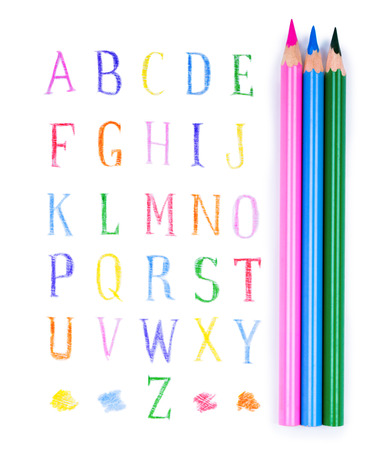 pencils and eraser on the background of the alphabet photo