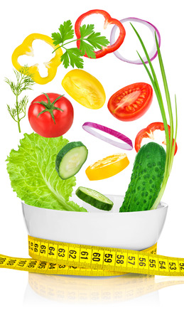 oncept: Vegetables for weight loss in a white bowl wrapped with a measuring tape. ?oncept diet