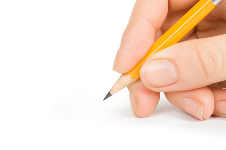 Woman hand with pencil on a white background photo