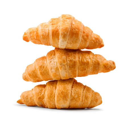 buttery: pile of fresh and delicious croissants on a white background Stock Photo
