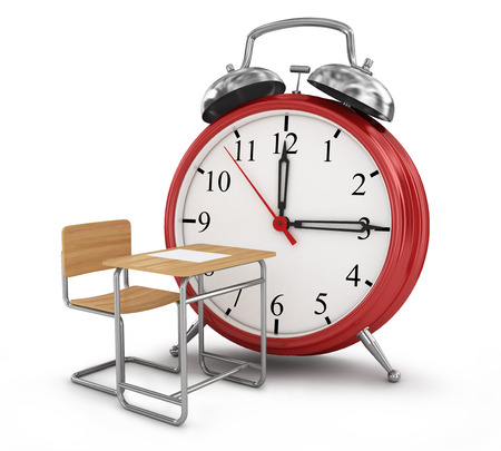 school time: alarm clock with school desk. School time concept. Stock Photo