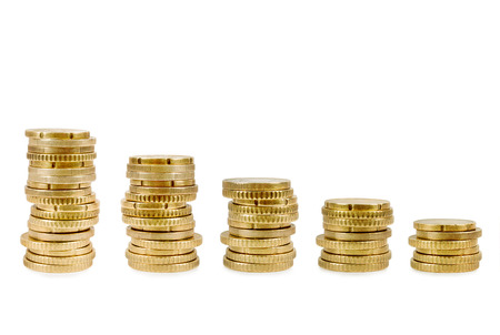 Stacks of golden coins isolated on white background. photo