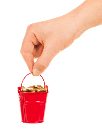 stainless steal: Hand holding a small bucket of coins on white background Stock Photo