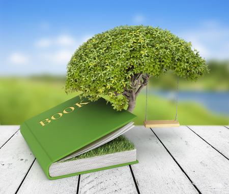 自然の背景に本のうち成長の知識の木