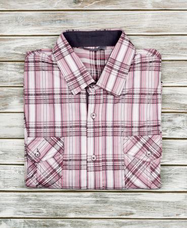 man shirt: T-shirt on a wood background