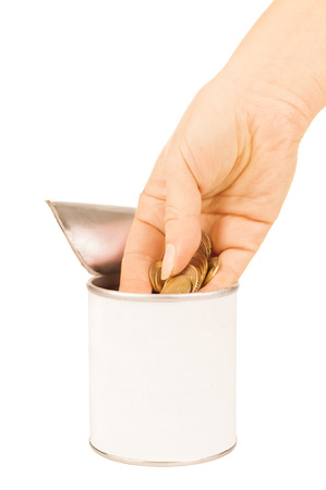 put: hand put coin in tin with Stock Photo