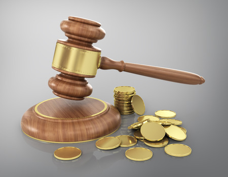 arbitrater: Concept of law. Wooden gavel with gold coins.