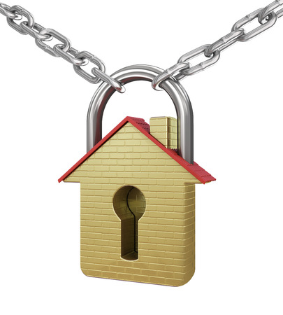 House in the shape of a gold padlock. Concept of save. photo