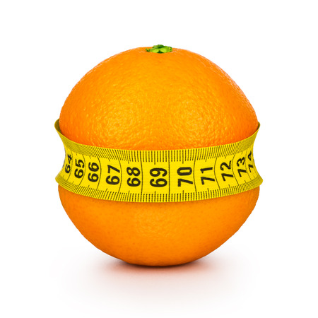 tightened: orange tightened measuring tape on a white background. Concept slim figure. Stock Photo