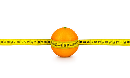 tightened: orange tightened measuring tape on a white background. concept of diet