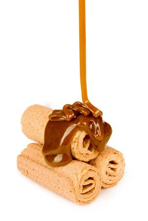 caramel sauce: sweet caramel sauce is poured on a waffle cookies