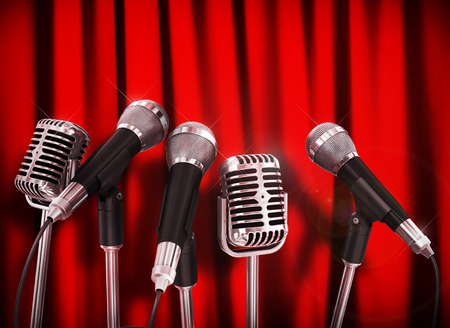 talker: Conference meeting microphones prepared for talker over Red Curtains.