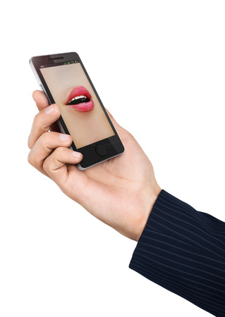 Phone speak concept. Mans hand holding phone with speaking womans mouth in display.