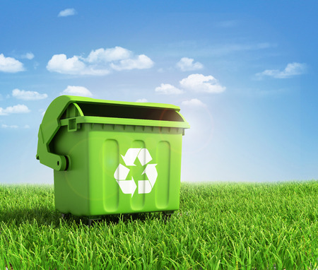 Green plastic trash recycling container ecology concept, with landscape background. Stockfoto