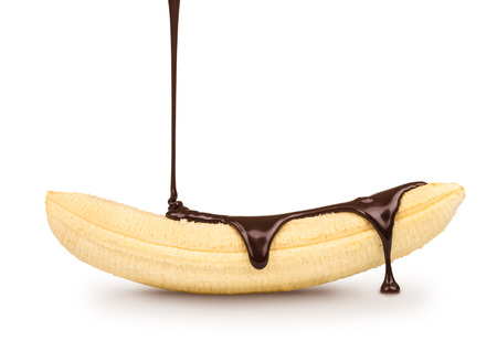 banana peel: dark chocolate is poured on the ripe banana on a white background