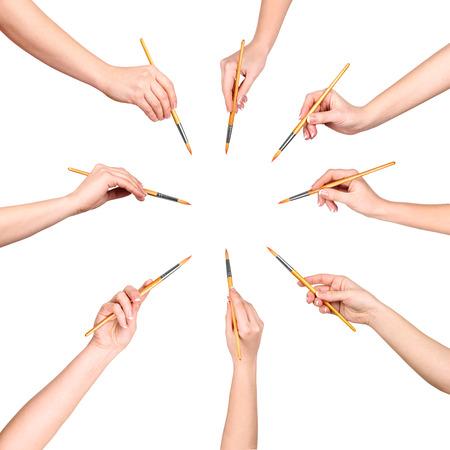 body paint: colecci�n de muchas manos con pincel aisladas sobre fondo blanco