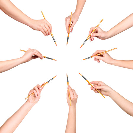 collection of a lot of hands with brush isolated on white background Stock Photo