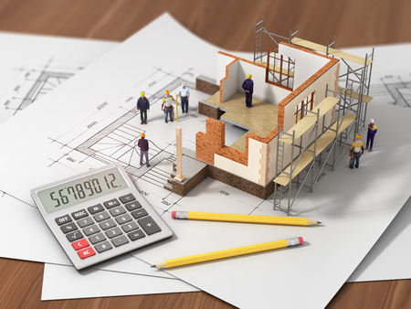 House with open interior on top of blueprints, documents and mortgage calculations and builbers. Construction concept.