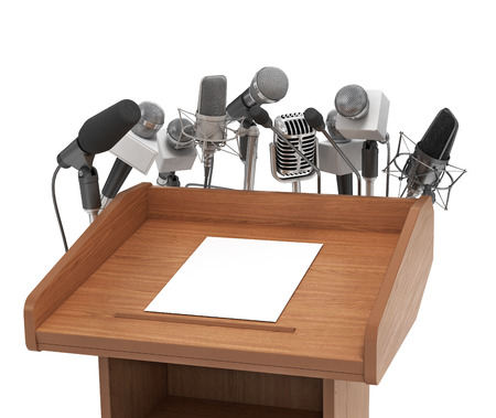 Conference meeting microphones with tribune on white background. Stock Photo