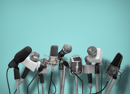 conference: Press conference with standing microphones.